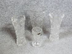 Four handcut crystal vases. A matching pair with star design, a large star cut vase and a smaller
