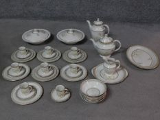 A Royal Doulton White Nile pattern part dinner service, including coffee pot, tea pot and coffee