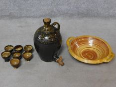 A collection of Mid Century Cooper Pottery studio glazed stoneware pieces including a tapped flagon,