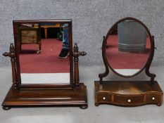 A Georgian mahogany swing frame toilet mirror fitted with base drawers and original plate and a