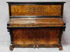 A late 19th century German burr walnut cased and ebonised metal framed piano with makers marks and