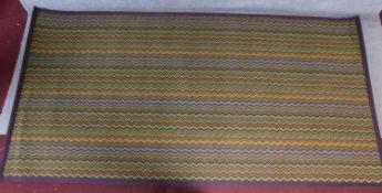 A contemporary multicoloured geometric zigzag rug 202x400cm