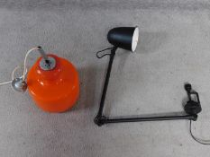 A vintage orange glass and chrome ceiling lamp along with a matte black metal screw on adjustable