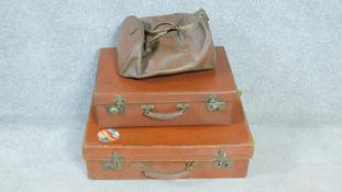 A collection of vintage leather luggage. Including two leather suitcases, one with a patterned