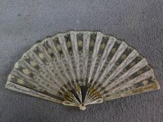 A French 'Directoire' Fan, the ivory guard with carved and painted foliate decoration, the cream