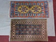 An antique Baluch rug, Persia, c.1900, c. 140 x 90 cm A modern Turkish rug, 20th century, 178x76cm