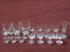A collection of nineteen antique and vintage blown glass glasses. Including a set of four faceted