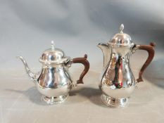 A Georgian style silver plated Barker & Ellis coffee and tea pot along with a cased set of Yeomans