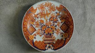 A large Chinese/Japanese hand painted Imari charger with floral and phoenix motifs. Six character