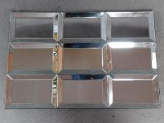 A wall mirror with nine glazed frame sections. 90x60cm