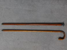 A Chinese bamboo carved walking stick together with an Edwardian gentleman's cane with a white metal