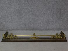 A 19th century brass and iron fire kerb with heraldic motifs. H.19 W.155 D.39cm