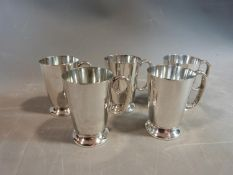 Five Larder & Burgess silver plated handled tankards. Stamped to base with makers mark, EPNS, A1,