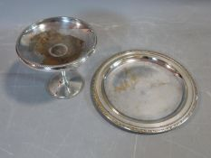 A silver plate pedestal bowl stamped D & P for Davies and Powers and a round tray with repousse