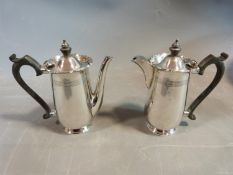 A pair of sterling silver cafe au lait pots by Walker & Hall. Hallmarked, Sheffield, 1949. With