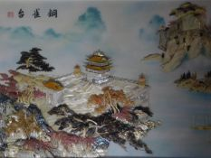 A large framed and glazed Chinese abalone shell and mother of pearl relief artwork depicting a