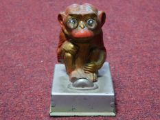 A vintage painted tin plate monkey light, it's eyes light up and is battery powered. H.12cm