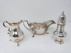 A collection of silver including a three footed antique cream jug, hallmarked worn, a three footed