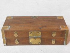 A 19th century Chinese hardwood brass bound table top chest of two long drawers. H.15 W.50 D.22cm