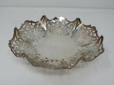 A fluted pierced silver bonbon dish with stylised floral design. Hallmarked: EV for Viner's Ltd.,
