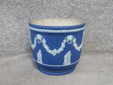An antique Jasperware blue and white Wedgwood planter. Decorated with vine garlands, lion head