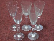 A collection of antique hand blown wine glasses with tear drawn bubble stems. H.22cm