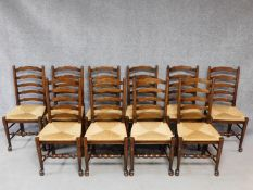 A set of ten antique style oak ladderback dining chairs on stretchered turned supports. H.100cm