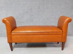 A tan leather Prestbury bench with hinged lid revealing a storage compartment. H.70 W.130 D.45cm