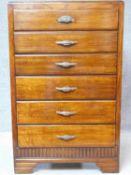 A vintage mid 20th century oak chest of six drawers on bracket feet. H.120 W.75 D.40cm