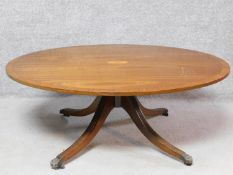 A Regency style mahogany, crossbanded and satinwood inlaid low coffee table on reeded quadruped