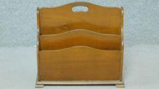 An Edwardian mahogany four division magazine rack. H.40 W.43 D.21cm