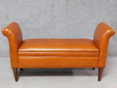 A tan leather Prestbury bench with hinged lid revealing a storage compartment. H.70 W.133 D.45cm