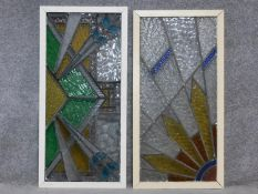 Two framed Art Deco stained glass panels with an abstract sunburst design. 92x45cm
