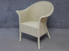A vintage style Lloyd Loom conservatory armchair with makers label. H.82cm