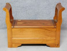 A Continental style hardwood bench with hinged seat revealing storage compartment. H.68 W.97 D.37cm