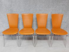 A set of four contemporary tan leather dining chairs on chrome supports. H.94cm