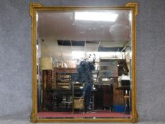 A large 19th century gilt and gesso framed overmantel mirror fitted with bevelled plate. 183x165cm