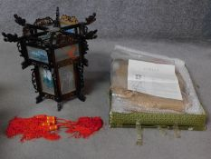 Two Chinese hand painted palace lamps. (one never used, still in its package). H.41cm