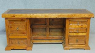 An Eastern teak pedestal desk with an arrangement of five drawers. H.78 W.179 D.59cm (from treated