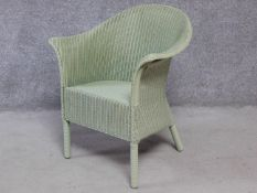 A vintage style willow green lacquered Lloyd Loom conservatory armchair with makers label. H.81cm