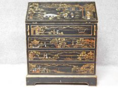 An Edwardian lacquered Chinoiserie bureau with fall front revealing fitted interior above four