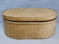 A wicker ottoman fitted with lift out tray by Oka. H.46 W.110 D.72cm