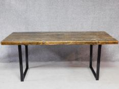 A 20th century pine planked top refectory table on metal supports. H.78 W.190 D.87cm