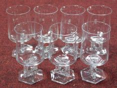 A set of seven Austrian mid century wine glasses with stylised floral design square stems with