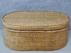 A wicker ottoman fitted with lift out tray by Oka. H.45 W.111 D.72cm