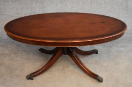 A Georgian style flame mahogany and crossbanded low table on swept qauttreform supports. H.54x124cm