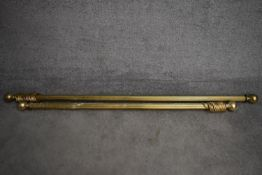 Two brass fluted curtain poles and rings with spherical finials. Longest L.165/Shortest L.138cm