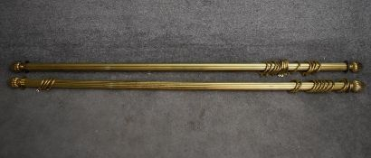 Two brass curtain poles and rings with shaped reeded finials. Longest L.174/Shortest L.167cm