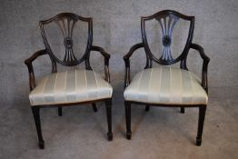 A pair of mahogany Hepplewhite style armchairs with striped damask stuffover seats on tapering