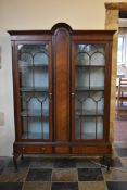 A late Victorian mahogany and ebonised domed top display cabinet with astragal glazed doors and